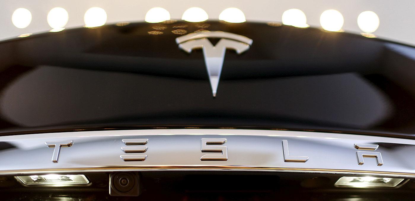 Tesla raises $2 7B in expanded stock, bond sale