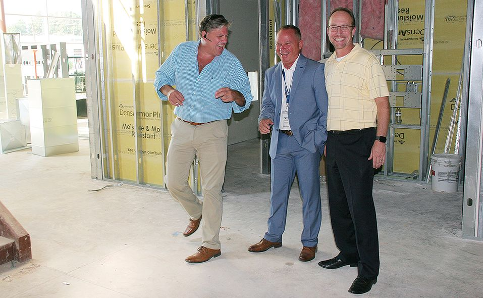From left to right: Scott Daugherity, senior project manager at PRO Building Systems in Atlanta, Hennessy Ford Lincoln Atlanta Fixed-Operations Director Sammy Hayes and Steve Ellis, design director at PRO Building Systems, show off progress at the new dealership under construction.