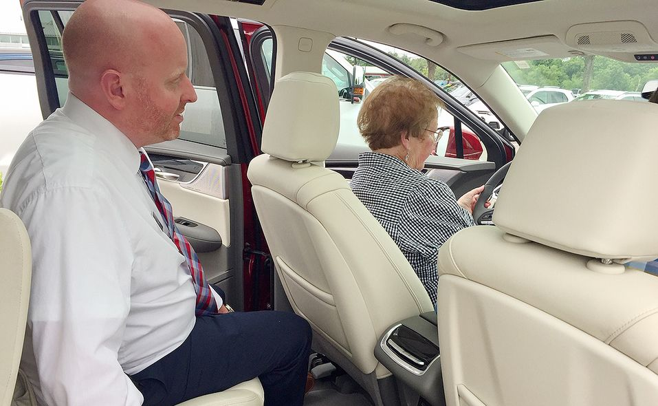 David Lucia, a salesman at Flemington Chevrolet-Buick-GMC, explains some of the features of the 2020 Cadillac XT6 to Sally Ashmen of Washington Crossing, Pa. She and her husband Barry pick up their new vehicle on July 31.