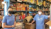 Volunteers from Williams Subaru in Charlotte, N.C., stepped in to help Common Heart food pantry organize and stock goods as well as pack food boxes for delivery.