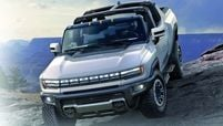 The GMC Hummer EV pickup has 35-inch tires, three electric motors that produce 1,000 hp and a removable Infinity Roof.