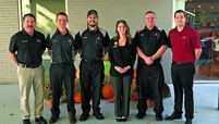 Cameron Baker, second from left, started the affirmation practice at the dealership. With him are, from left, Ken Mandell, Nathanial Zanavich, Bonnie Gramling, Steven Lewis and Brad Burns.