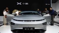 Xpeng P7 sedan on display at an auto show