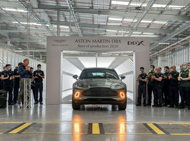 Employees at Aston Martin's plant in St Athan, Wales, cheer the first DBX driven off the production line.