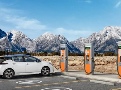 An electric car charges at a ChargePoint station