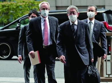 Greg Kelly, left, an American former representative director of Nissan, is on trial in Japan in the case involving Carlos Ghosn's compensation package.