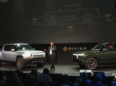 Rivian's electric pickup truck and SUV on display at an auto show