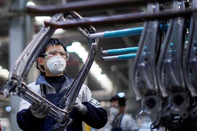China's auto industry stirs, but still far from normal