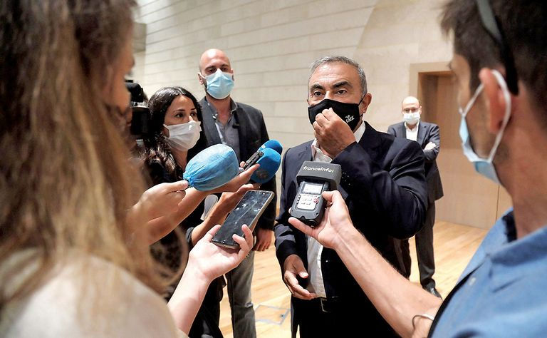 Ex-Nissan Chairman Carlos Ghosn speaks last year with journalists in Lebanon, where he fled to in late 2019.