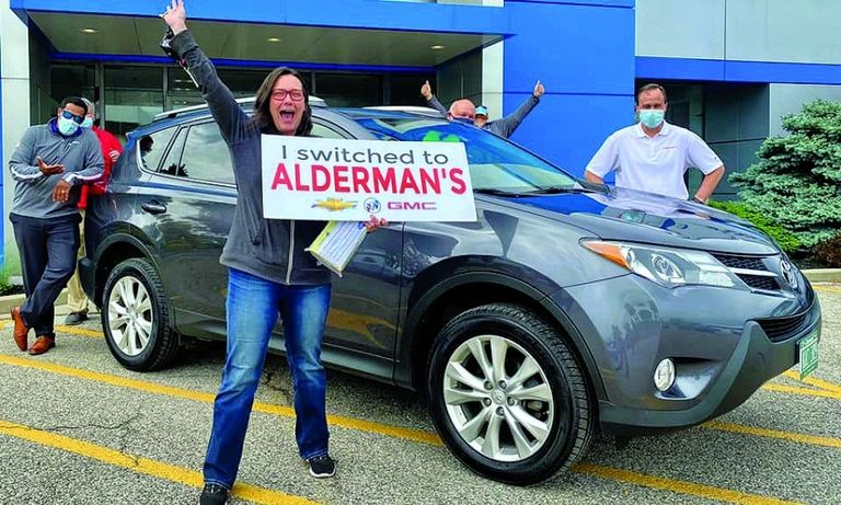 Tamia Fleming celebrates her 2015 Toyota RAV4 Limited with a sign the dealership made for photos.