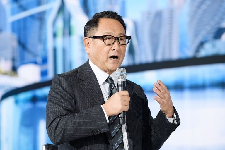 AkioToyoda speaking with a microphone