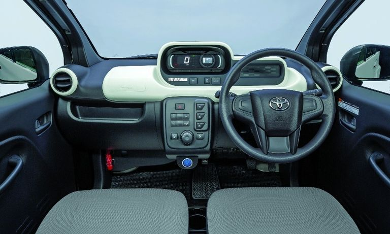 The Toyota C+Pod's interior has a stripped-down, minimalistic feel, with big knobs and buttons.