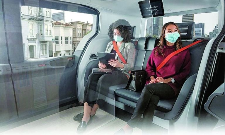 Cruise's driverless Origin shuttle would carry two passengers at a time separated by a clear barrier.