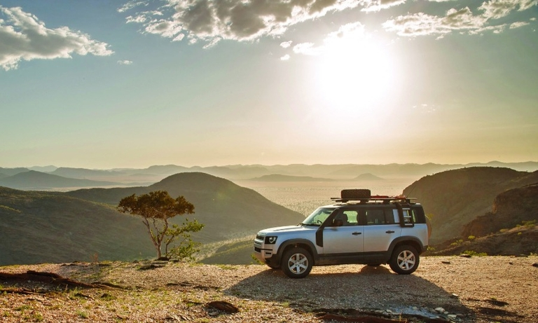 While you're video conferencing, you can picture yourself driving a Defender in Namibia, an I-Pace in Spain, bottom, or an Evoque in Greece, inset.