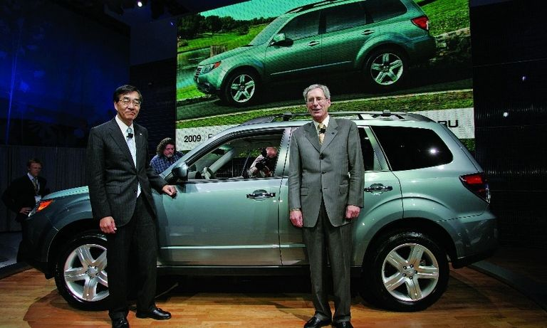Ikuo Mori, then Fuji Heavy Industries CEO and Tom Doll, stand alongside the redesigned 2009 Subaru Forester, which debuted at the 2008 Detroit auto show. The redesigned crossover helped kick-start Subaru's U.S. sales growth.