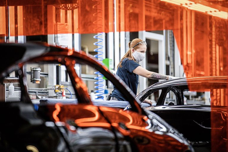 A worker assembles a Mercedes-Benz vehicle