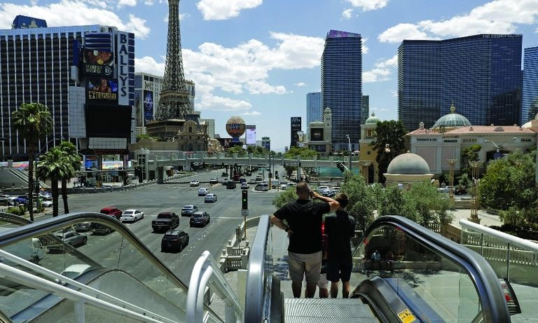Getting around in Las Vegas often involves long waits for a crowded monorail ride, below, or taking escalators up and down to cross elevated pedestrian walkways along the Strip.