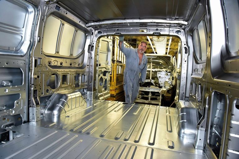 A Transit van undergoes inspection in the body shop of Ford's Kansas City assembly plant in August 2019