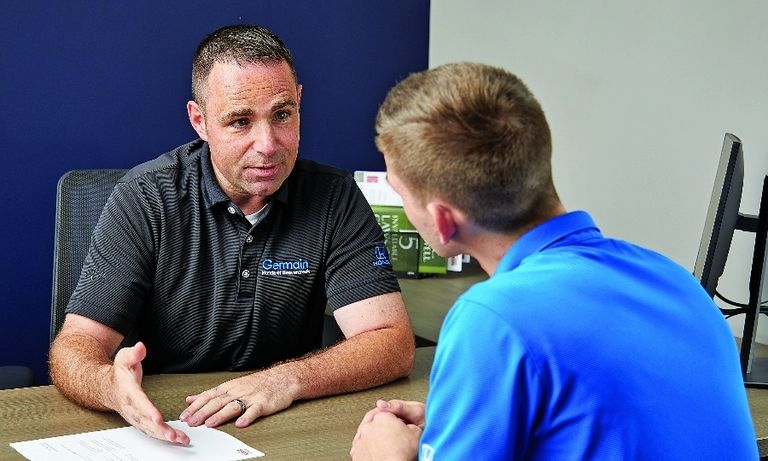 At Germain Academy, Steve Burden, a Germain Honda sales consultant, does an exercise with an associate.