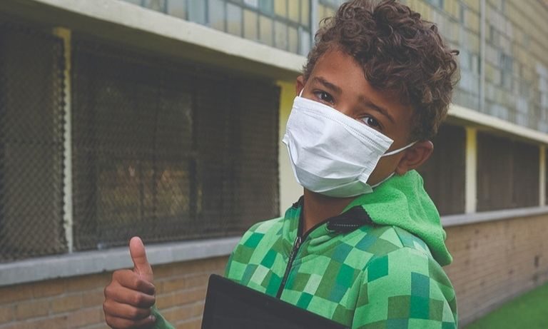 Nathen Hamrick, 10, and Kia Bonner, 17, below, both of Detroit, received face masks Tuesday, Sept. 1, at the city's Cody High School as part of GM's donation.