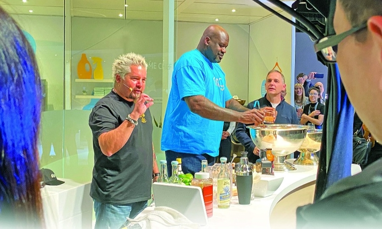Guy Fieri, left, and Shaquille O'Neal prepare cocktails at an Amazon media event during CES last week.