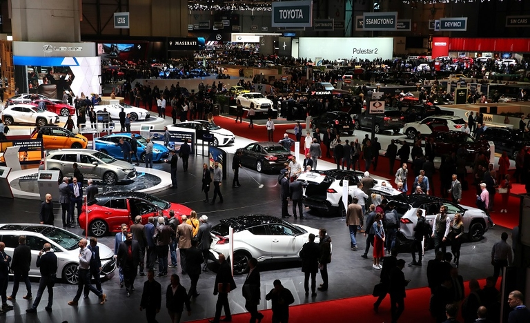 Visitors are pictured at the 2019 Geneva auto show. Organizers said they will step up cleaning and disinfection at this year's event.