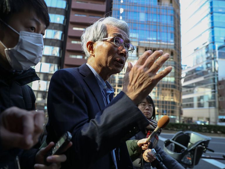 Lawyer Junichiro Hironaka talks to reporters