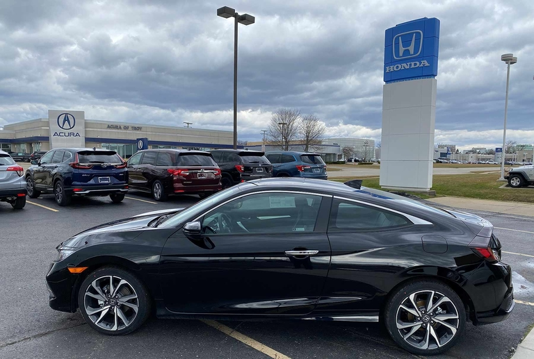 HONDA-ACURA: March volume nearly halved by virus scare