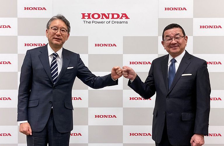 Incoming Honda CEO Toshihiro Mibe poses for a photograph with outgoing CEO Takahiro Hachigo during a news conference in Tokyo.