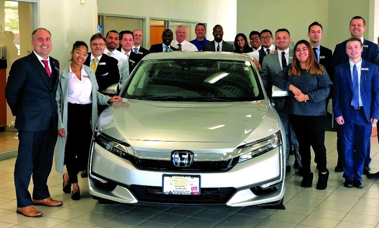 The staffs of Kelly Honda, above, and Kelly Nissan of Lynnfield, below, enjoy the strategy.