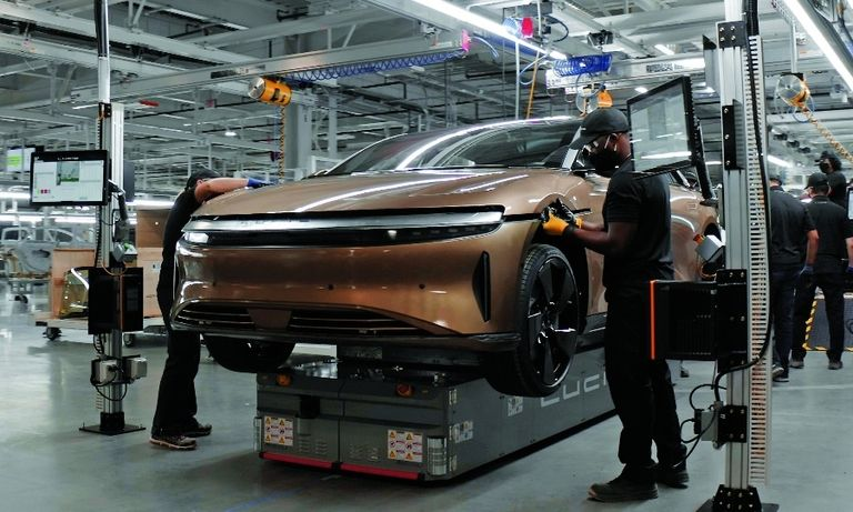 Lucid employees work on the company's first vehicle — the electric Air sedan, which is set to begin production in 2022.