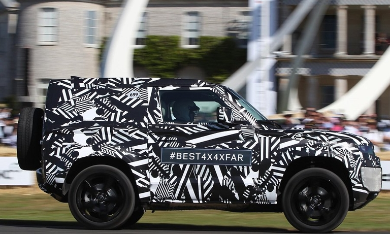 Land Rover keeps new Defender disguised in Goodwood hill climb