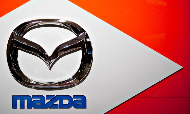 Mazda profit slumps 76% on currency hits
