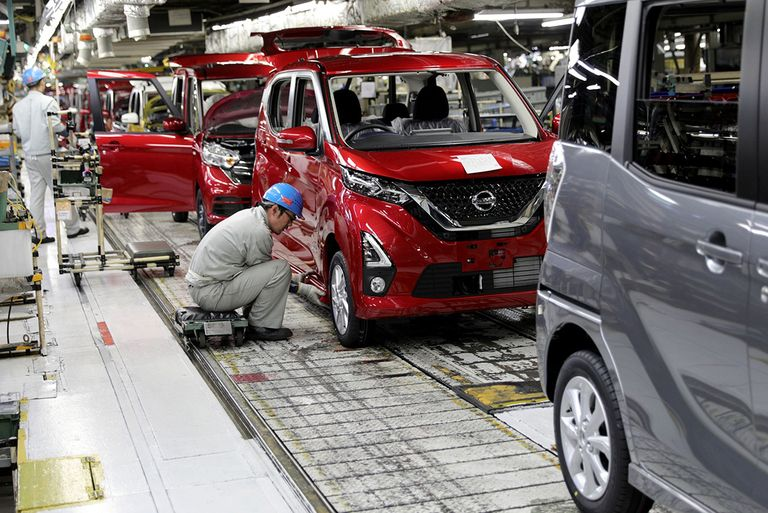 Workers on the production line at a Nissan factory in Japan