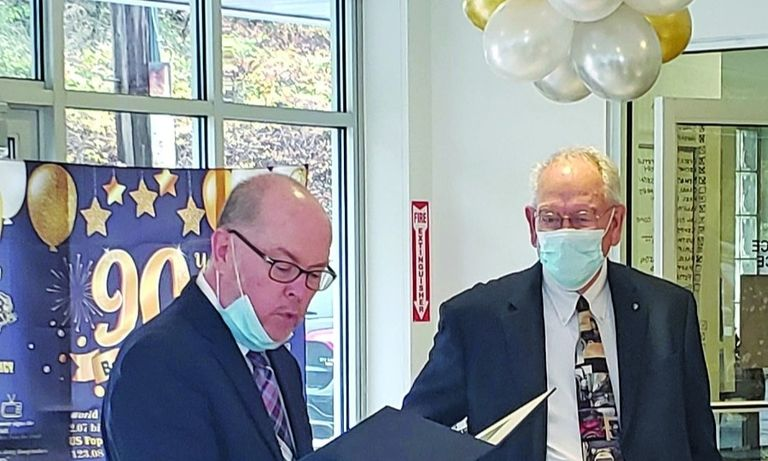 Quentin Strouss, right, received proclamations from the state of Pennsylvania, read by Rep. Jim Marshall, and the city of Beaver Falls during his retirement celebration on Oct. 30.
