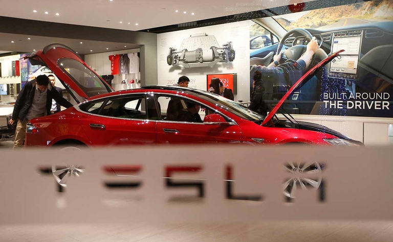 Tesla reaches deal clearing way for Michigan service centers, report says