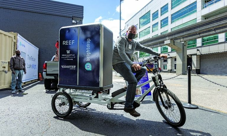 Coaster Cycles and a ghost kitchen, below, are part of the Seattle Neighborhood Delivery Hub.