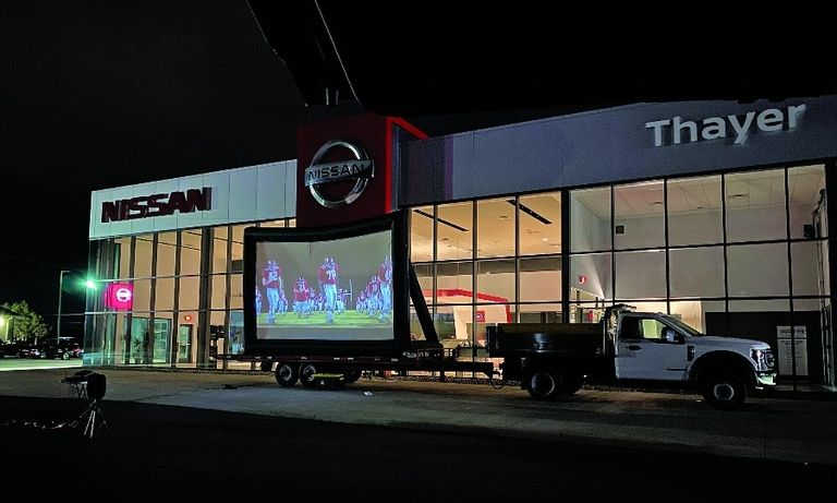 Thayer bought a screen and projector to show the movies and alternated the site among its six stores.