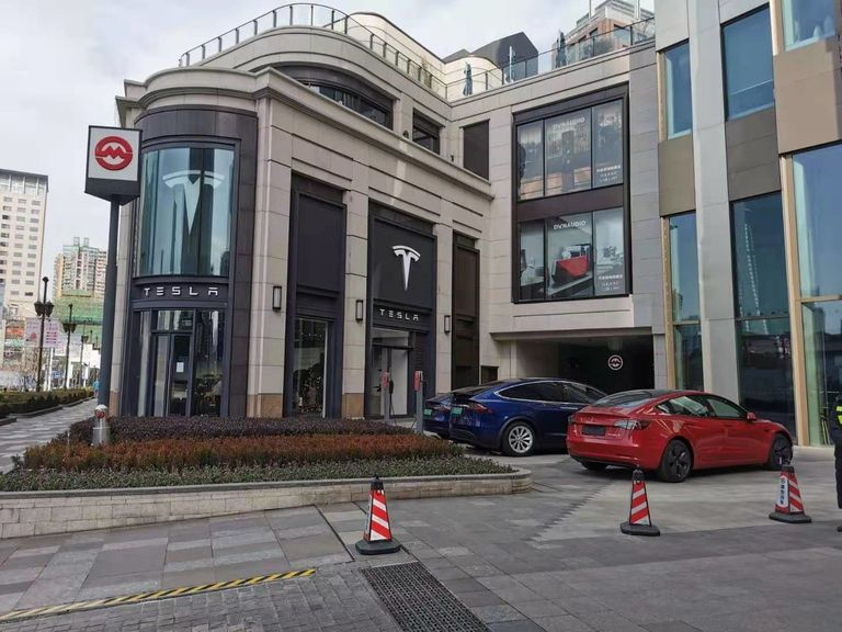 Charging poles installed outside a Tesla store in downtown Shanghai.