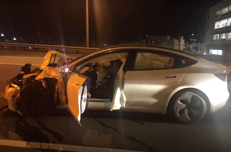 A Tesla Model 3 sedan hit a parked police cruiser with its hazard lights flashing on a major highway near Norwalk, Conn.