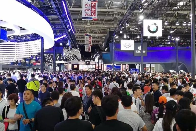 Auto show plans highlight need to defeat virus