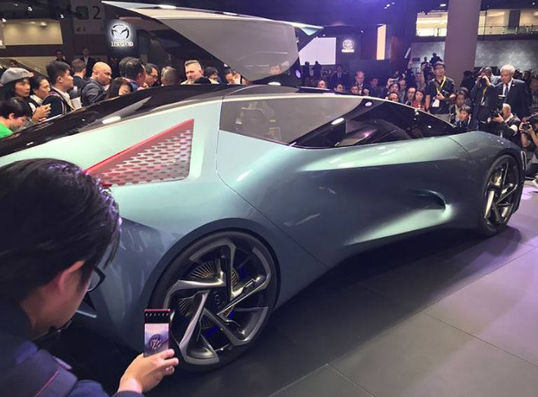 Press surround a concept car at the 2019 Tokyo Motor Show