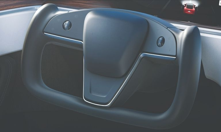 Tesla's yoke-style wheel has two scrolls and will use buttons to activate some functions.