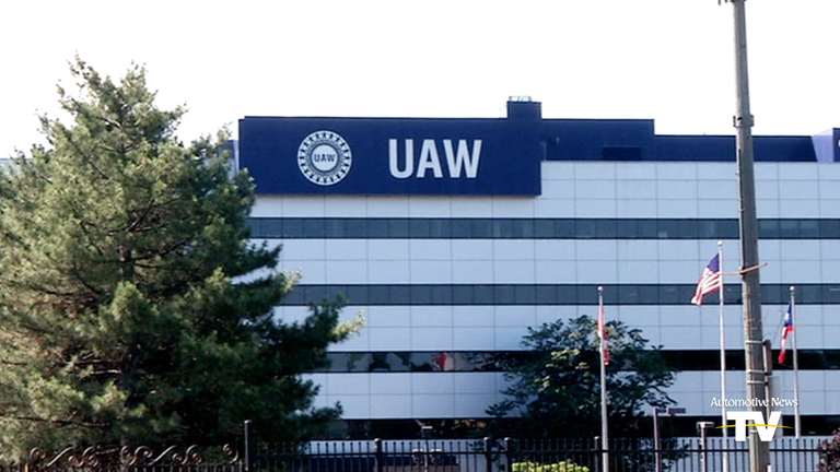 UAW official charged in corruption probe takes leave of absence
