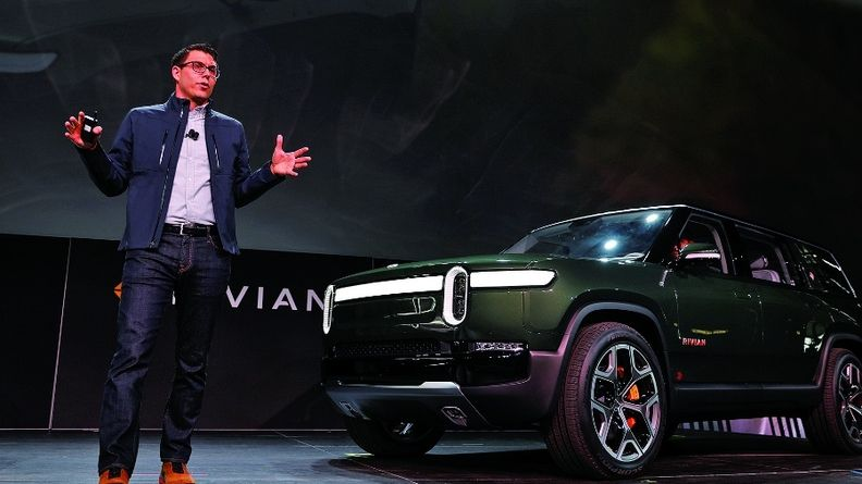 """CEO RJ Scaringe, with the R1S at the 2018 Los Angeles Auto Show, says """"a significant majority of service operations necessary on a vehicle can be done remotely."""""""