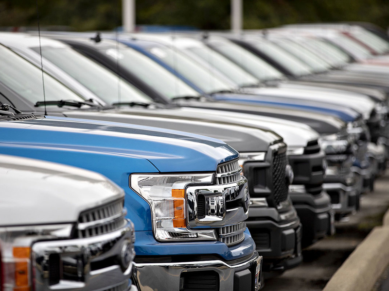 Auto dealers warily argue for right to stay open
