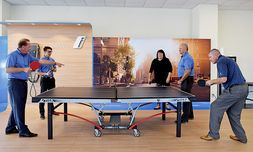 A management meeting around the pingpong table promotes teamwork. From left, Scott Davis, general manager; Adele Chanthavane, finance director; Marianne Castleberry, sales manager; Randy Ziegler, service director; and Jeff Gogal, sales manager.