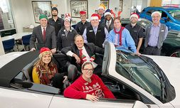 COO Tim Bergstrom, in the driver's seat, and Bergstrom Ford-Lincoln of Neenah team members on Holiday Spirit Day