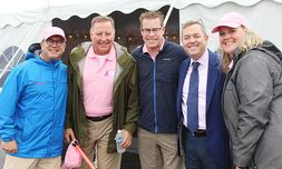 General Manager Rick Bergstrom, left, Vice President Robin Auth, center, and Executive Vice President John Hogerty II, second from right, at Bergstrom's annual Drive for a Cure event benefiting breast cancer research
