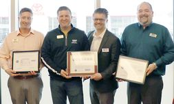 From left, BDC Manager Denny Eubank, Dealer Alex Casebeer, General Manager Matthew Casebeer and BDC Director Brian Schindler receive the Seven Seals Award for their service to National Guard members and reservists.